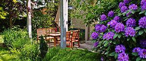 Onderhouden van tuin met grasmaaier